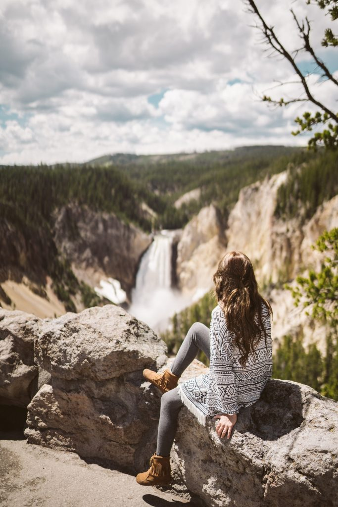 Woman looking at Lower Falls in Yellowstone