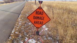 Road Damage Ahead sign