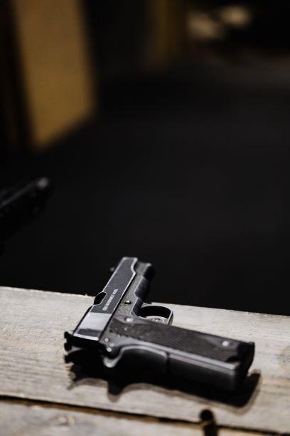 Gun on wooden table